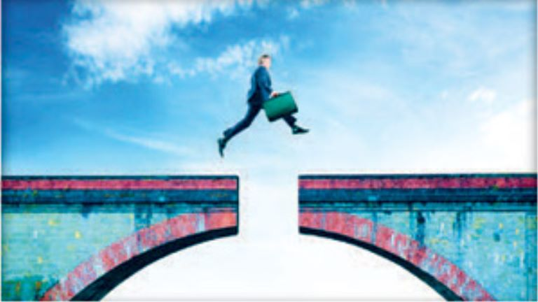 man jumping over a bridge