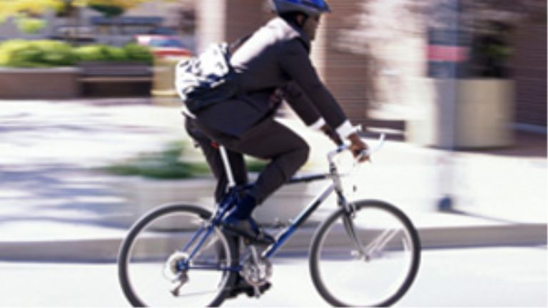 businessman riding a bike through the city
