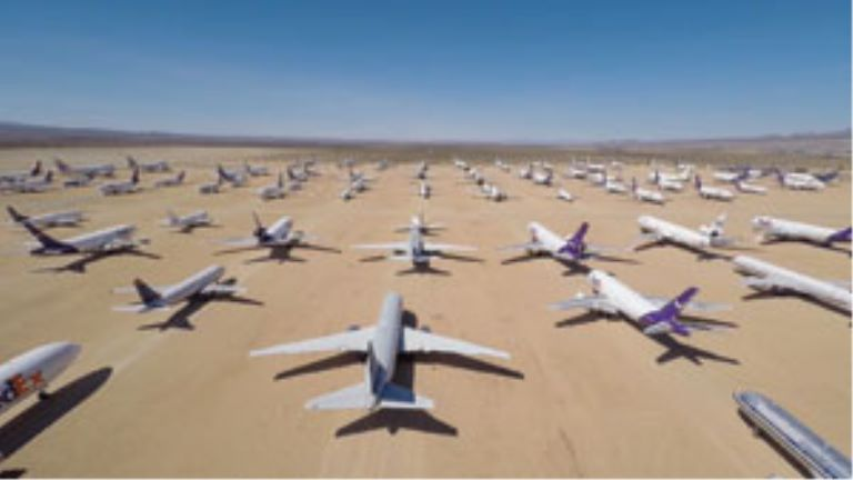 runway with rows of planes