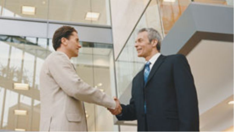 Two business men shaking hands