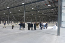 people walking around an empty warehouse
