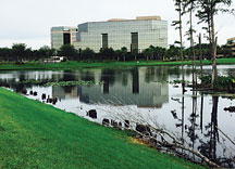 exterior view if a building on a pond