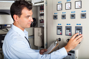 man monitoring electrical systems in a building